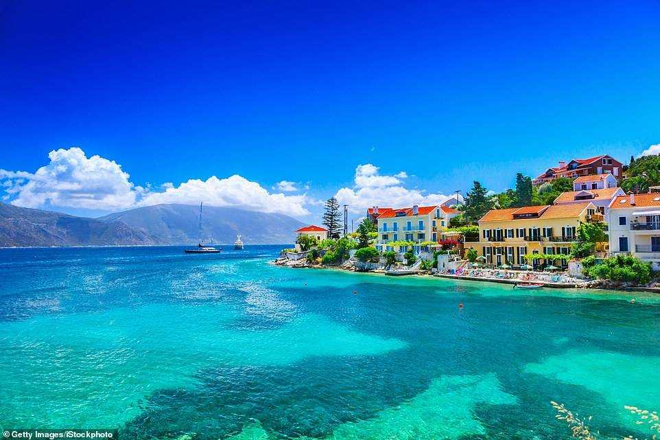 Ray of hope: We could head to Greek islands like Kefalonia, pictured, as Greece's tourism minister Haris Theoharis has said he is hoping for a 'semi-normal summer'